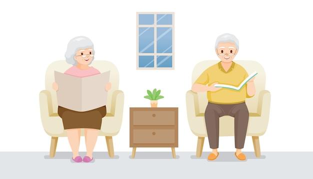 Dwie starsze osoby siedzące na sofie, czytające książkę i gazetę, pozostań w domu, zachowaj bezpieczeństwo, samoizolacja, ochrona przed chorobą koronawirusa, clvid-19