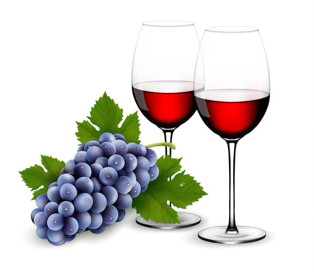 Dwie szklanki czerwonego wina z winogronami.