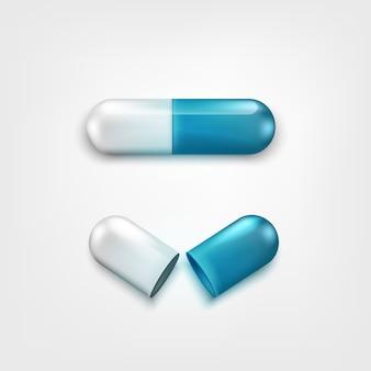 Dwie tabletki kapsułki biały i niebieski kolor na białym tle. jeden otwiera i zamyka. tło dla apteki lub drogerii. element koncepcji medycyny lub farmacji