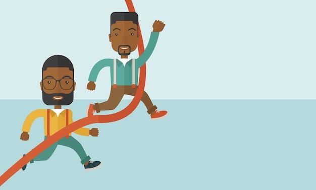 Dwóch afrykańskich facetów biegnących do mety.