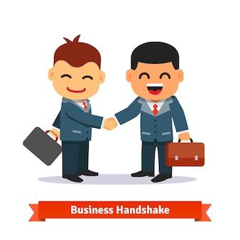 Dwóch biznesmenów drżenie rąk