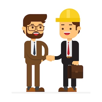 Dwóch biznesmenów rozmawia i potrząsa ręką