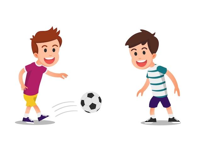 Dwóch chłopców grających w piłkę nożną