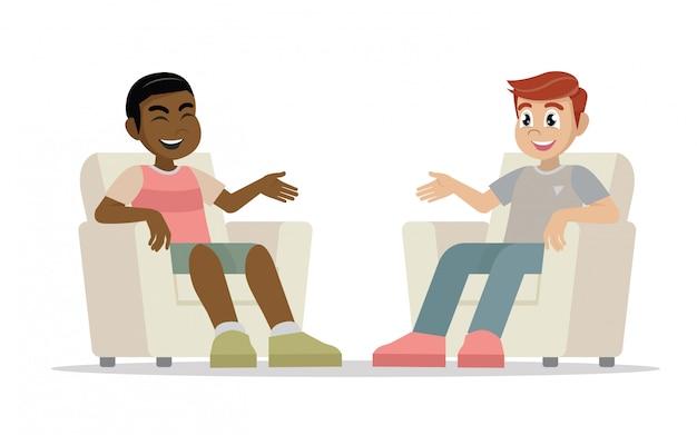 Dwóch mężczyzn siedzących na krzesłach twarzą do siebie i rozmawiających.