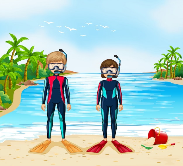 Dwóch płetwonurków w kombinezon stojący na plaży