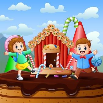 Dwoje dzieci bawi się w słodkiej krainie