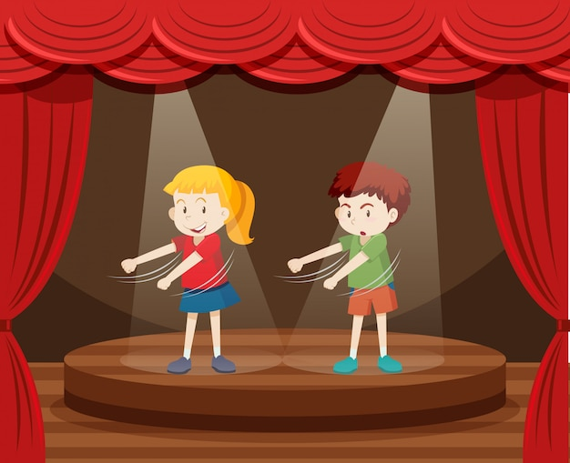 Dwoje dzieci tańczy na scenie