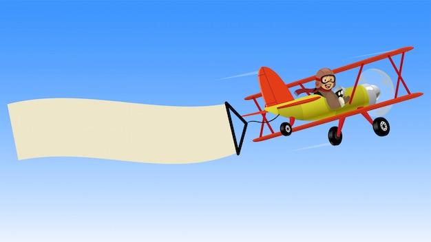 Dwupłatowy samolot lecący z pustym sztandarem