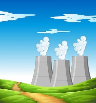 Dym wydobywający się z kominów w polu