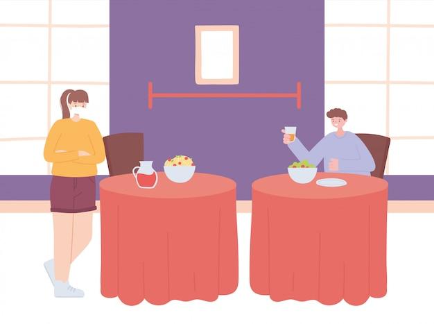 Dystans społeczny w restauracji, młodzi ludzie siedzą przy stołach oddzielonych od siebie i jedzą, pandemię, zapobieganie infekcji koronawirusem