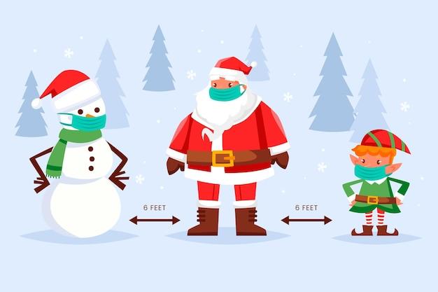 Dystans społeczny z różnymi postaciami bożonarodzeniowymi z maską medyczną