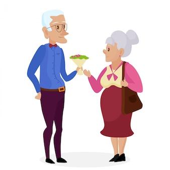 Dziadek daje kwiaty babci