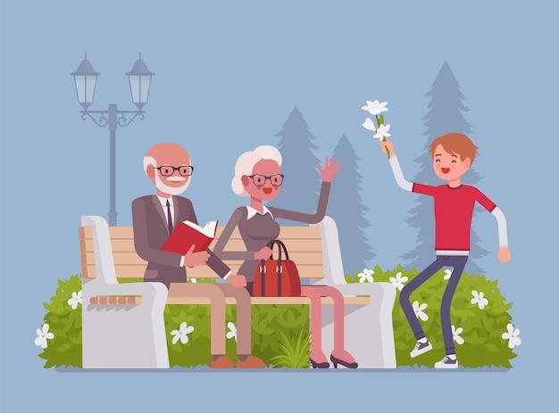 Dziadkowie i wnuk w parku. szczęśliwi emeryci, starsi ludzie spotykają się z wnukiem, są przyjaciółmi i mają dobre relacje, wspólnie spędzają czas na świeżym powietrzu. ilustracja kreskówka styl