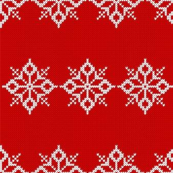Dzianinowy wzór świąteczny. czerwone tło. ilustracja wektorowa.