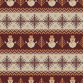Dzianinowy wzór z bałwanki i płatki śniegu.