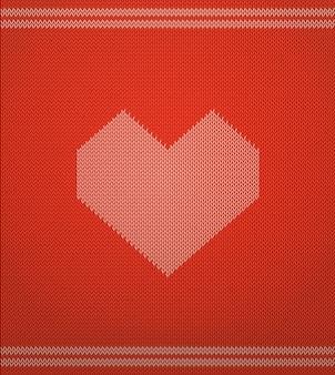 Dzianinowy wzór z czerwonym sercem