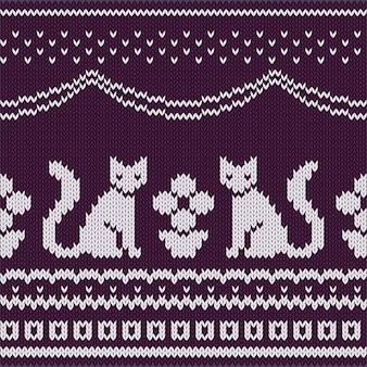 Dzianinowy wzór z siedzącymi kotami i rośliną doniczkową.