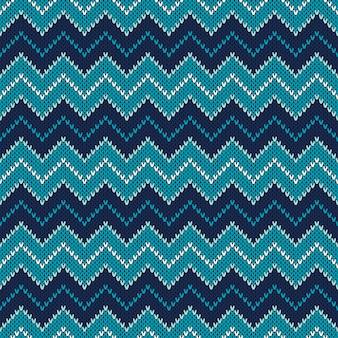 Dzianiny wzór chevron. sweter w stylu fair isle. streszczenie bezszwowe tło z dzianiny