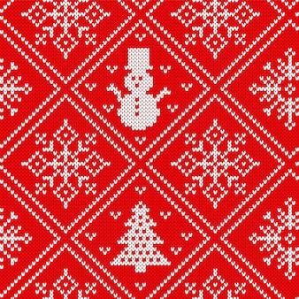 Dzianiny wzór świąteczny. bezszwowe tło z dzianiny. . tekstura sweter xmas. świąteczny czerwony nadruk