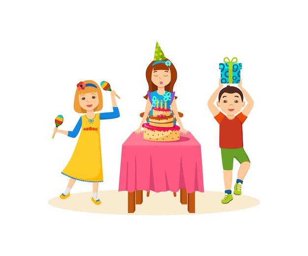 Dzieci bawią się w uroczysty wieczór na przyjęciu urodzinowym.