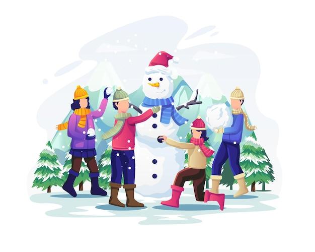 Dzieci bawiące się na śniegu i lepiące bałwana na świątecznej ilustracji świątecznej