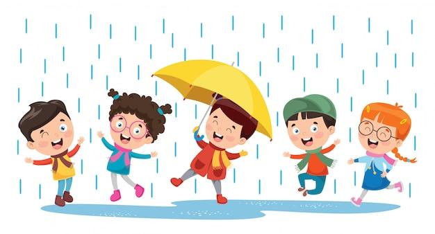 Dzieci bawiące się na zewnątrz w deszczu
