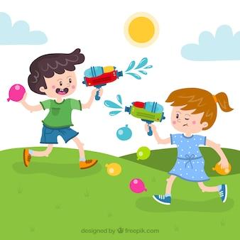Dzieci bawiące się pistoletami na wodę w partyku