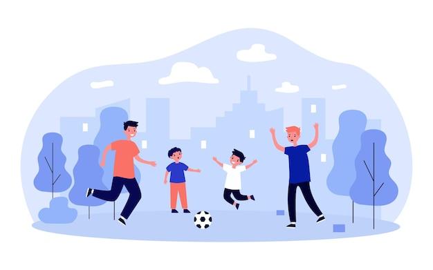 Dzieci grające w piłkę nożną lub piłkę nożną w parku