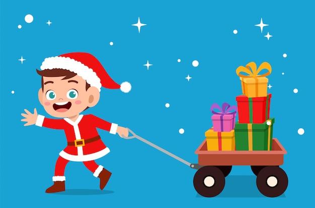 Dzieci niosą prezent świąteczny wektor