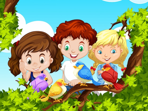 Dzieci patrząc na ptaki na gałęzi