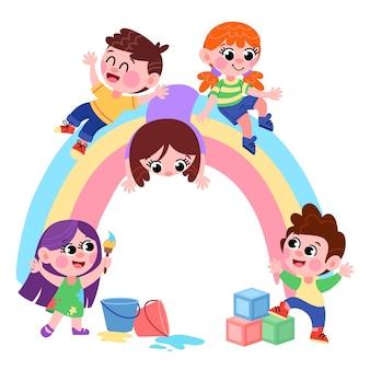 Dzieci rysują i siedzą na tęczy w przedszkolu bawią się aktywnie