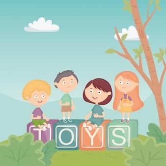 Dzieci siedzą na alfabet bloki w parku, zabawki