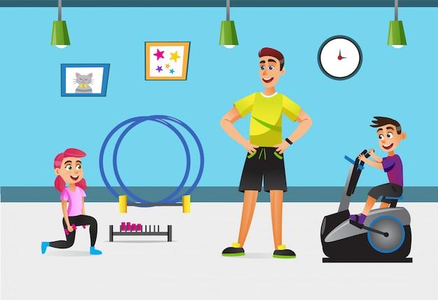 Dzieci trenujące w siłowni ze sprzętem sportowym.