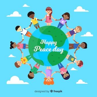 Dzieci trzyma ręki wokoło słowo pokoju dnia tła