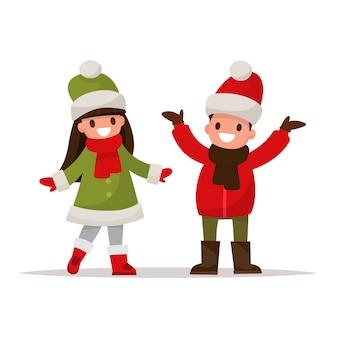 Dzieci ubrane w zimowe ubrania.