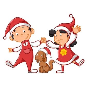 Dzieci używające świątecznej czapki i bawiące się z psem