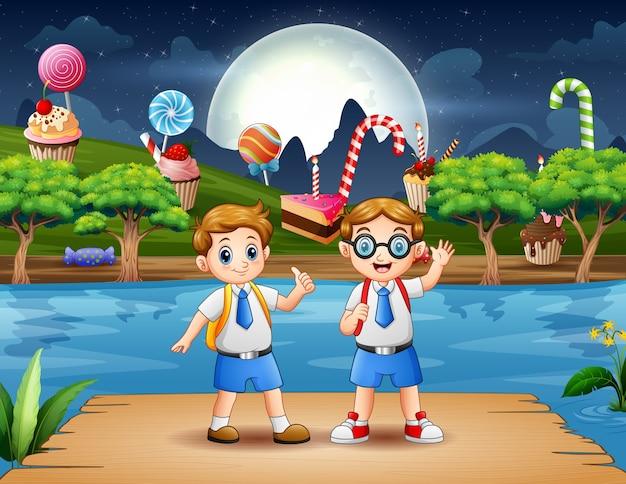 Dzieci w wieku szkolnym bawią się na drewnianym molo w nocy