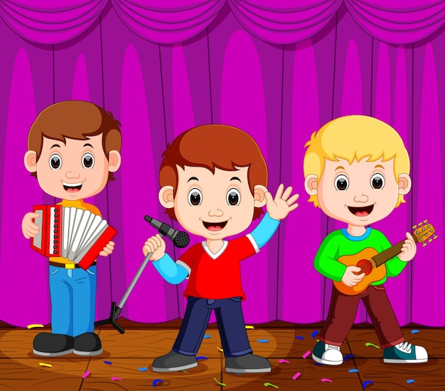 Dzieci w zespole grającym na scenie