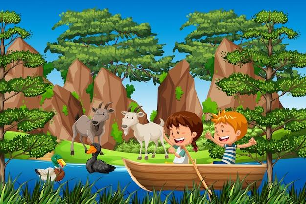 Dzieci wiosłują drewnianą łodzią w lesie