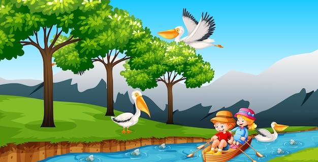 Dzieci wiosłują łodzią w scenie lasu strumienia
