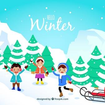 Dzieci z sledge zimowym tle