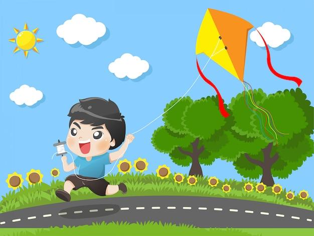 Dzieciak działa latawce w ogrodzie.