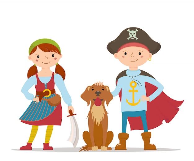 Dzieciaki w pirackiej fantazyjnej sukience i słodki pies labrador
