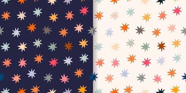Dziecinne bezszwowe wzory / tła / tapety z kolorowymi gwiazdkami