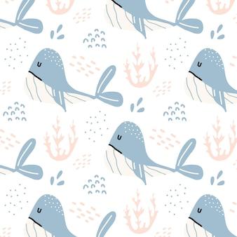 Dziecinny handdrawn bezszwowy wzór z niebieskimi wielorybami wzór z wielorybami i algami
