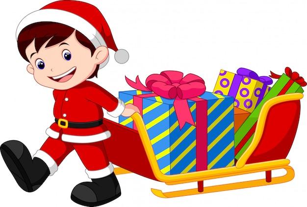 Dziecko ciągnące sanie pełne prezentów