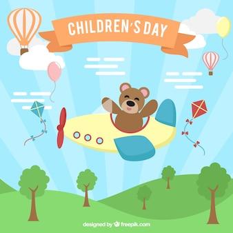 Dziecko dzień koncepcji z misiem pływających pod samolotem