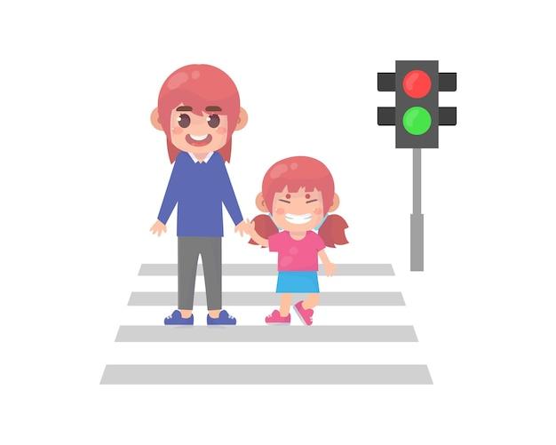 Dziecko z rodzicem przechodzi przez ulicę
