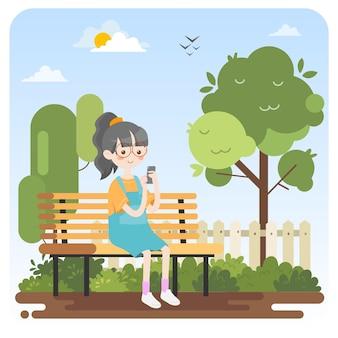 Dziecko za pomocą telefonu w parku
