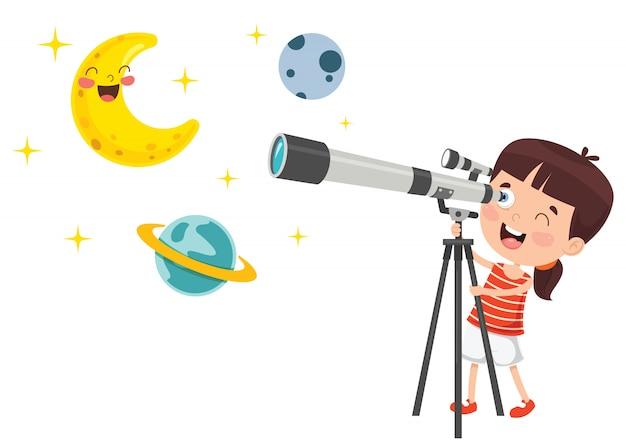 Dziecko za pomocą teleskopu do badań astronomicznych